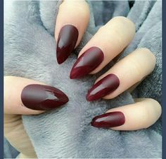 Deep red stiletto nails matte top coat shiny bottom