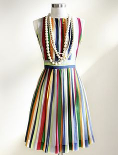 I would wear this without the bling, with some fabulous (solid) color shoes. Vertical stripes are so flattering.