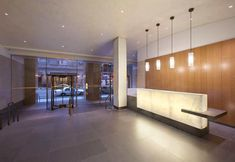 125 Park Avenue in NYC by Gertler & Wente is a renovation project featuring a backlit onyx reception desk and backlit feature wall