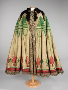 The suba is awe-inspiring with its use of sheepskin in the body of the garment as well as the full black lamb pelt draped over the shoulders The dense foliate embroidery and leather appliqués are characteristically Hungarian. Despite their grand appearance, subas served more than just festival purposes. For shepherds working outside they provided protection from weather, as well a seat or bed. The suba also served as a surface for eating or drying meat. 1840-1870 leather wool