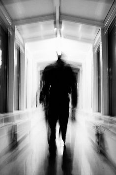 Silhouette Of A Man In Hallway Blurred Black And White Photo