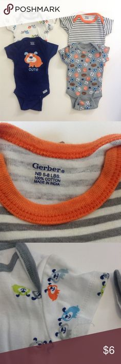 NB - 4 Gerber Onesies 4 adorable Gerber onesies. In good condition. Barely worn before my son grew out of them. Puppy one has some stitching coming out on the sleeve. Still tons of life in them! Gerber One Pieces Bodysuits