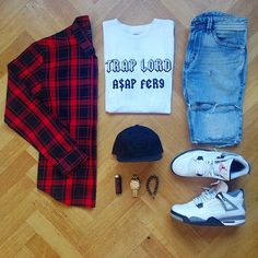 Red flannel, Trap Lord clo. Light wash ripped jeans, jordan retro 4, Stussy hat.