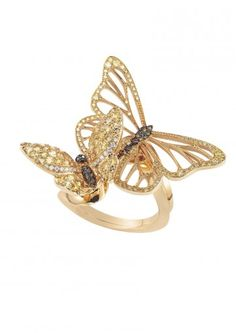 A DELICATE GEM-SET BUTTERFLY RING  LIMITED EDITION    Designed as a pair of fairy light golden butterflies, whose colored diamond and yellow sapphire openwork wings flutter delicately over the finger; wrapped in a rose gold band.