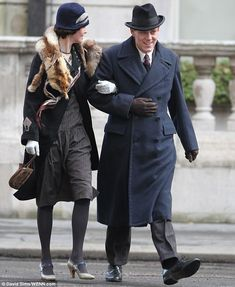 Time for an outing: Michelle was also seen shooting a scene later in the day in which she changed in a fur stole and dropped waist dress