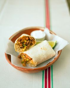 Homemade frozen burritos... AWESOME! I wonder what other veggies I can sneak in and therefore into my kids... ;p (Bean Burritos - Martha Stewart Recipes)