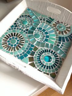 A nice tray with circles in teal colors. Made with glass mosaic and glass…