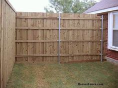Wood fence panels installed on round galvanized posts. Special wood to steel fence post brackets are available in a variety of sizes and type to accomodate attaching wood fence rails to round posts.