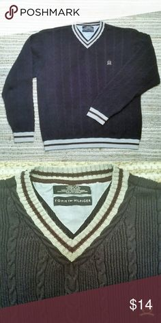 Tommy Hilfiger Navy Blue Cable Knit Sweater This men?s sweater is in excellent condition.  Pretty v-neck cable knit in navy blue with gray and maroon collar and cuffs.  Tommy Hilfiger crest embroidered on left breast.  Made of 100% Cotton.  Measured across one side of sweater: shoulder to shoulder 23?, armpit to armpit 23?, sleeve from shoulder seam 26?, collar to hem 32?. Tommy Hilfiger Sweaters V-Neck