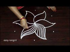 It is our tradition to draw kolam every day morning at the door steps. There are many benifits of drawing kolam in front of the house. It is auspecious and b. Easy Rangoli Designs Diwali, Indian Rangoli Designs, Rangoli Border Designs, Small Rangoli Design, Rangoli Ideas, Rangoli Designs With Dots, Rangoli With Dots, Beautiful Rangoli Designs, Kolam Designs