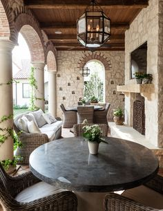 Phenomenal Outdoor Chairs decorating ideas for Exquisite Patio Mediterranean design ideas with arched openings brick columns lantern pendant light loggia outdoor fireplace outdoor seating