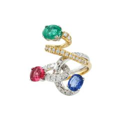 Twisted Love  18K Yellow & White Gold Ring   Gold: 10.80 gms Diamonds: 0.67 cts Emerald: 1.34 cts Blue Sapphire: 1.18 cts Tourmaline: 1.12 cts