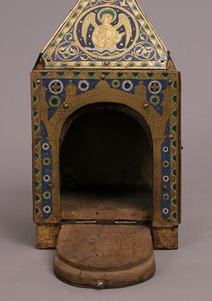 Tabernacle Date: ca. 1200–1210 Geography: Made in Limoges, France Culture: French Medium: Copper (plaques): engraved, scraped, stippled, and gilt; (appliqués): repoussé, chased, engraved, scraped, and gilt; champlevé enamel: blue-black, dark, medium, and light blue; turquoise, dark and medium green, yellow, red, and white; wood core, painted red Dimensions: Overall: 12 1/2 x 6 1/2 x 6 11/16 in. (31.8 x 16.5 x 17 cm)