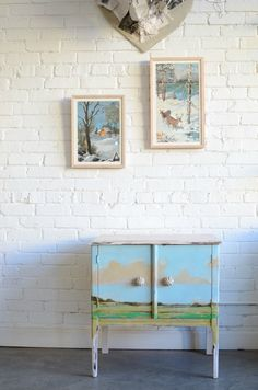 A little cabinet painted like a wide open space