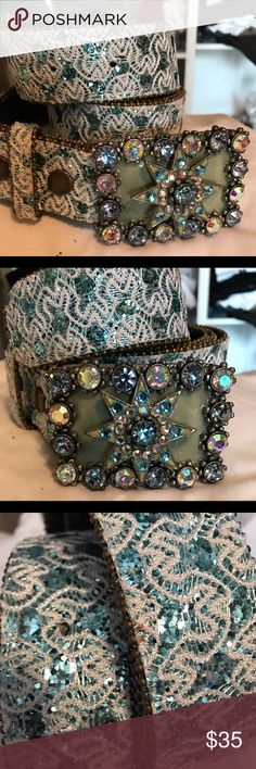 Aqua Crystal Star Belt Omg ❤️ these belts. Beautiful star design combining round stones and glitter woven into fabric belt. The buckle measures just under 3 inches and fabric belt a generous 40 inches. This is brand new never worn. Please note that because there is glitter in the design you might see some on your hands. Not to worry it doesn't compromise the cool look. Great with jeans or a dress Accessories Belts