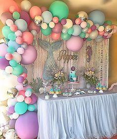 Pastel balloon garland and mermaid backdrop