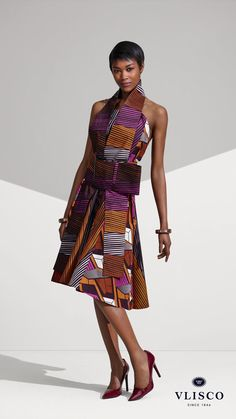 FLATTERING COCKTAIL DRESS | This universally flattering cocktail dress is crafted with two fabrics on the side, and in the front panel too... | Vlisco - The True Original