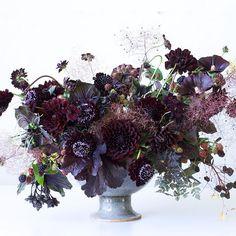 Black floral arrangement by Tulipina | blackberries, dahlias, scabiosa.