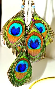 'Custom Feather Earrings Featured in DFW' is going up for auction at  6pm Tue, Oct 16 with a starting bid of $10.