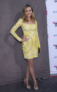 Elizabeth Olsen proving that she can wear colour we love this Emilio Pucci Spring 2012 long-sleeved mini-dress with cream lace trim. She matched the dress with simple nude Pucci sandals, but the bright shade works perfectly for her. Who knows when she'll wear something as bright and bold again.
