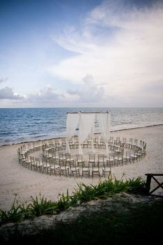 Beach Wedding setup idea: Set the guest chairs in a circle than in rows. Everyone has the perfect view of the wedded couple!  Enter the June Weddings Sweepstakes for a chance to win $500, and celebrate brides and grooms all month on #HallmarkChannel #June