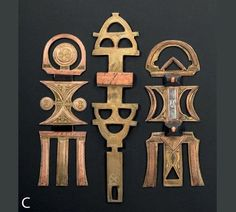 Tuareg veil weights Tassassarut ~ from the Tuareg people, northwest Azawagh, Niger | Brass, copper and iron | ca. 1940/50s. | These take the form of a traditional Tuareg padlock key.