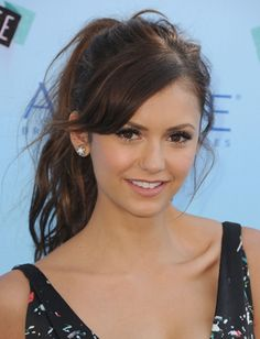 Nina Dobrev's messy ponytail and side-swept bangs <3 Visit www.makeupbymisscee.com for #hair and #beauty inspiration