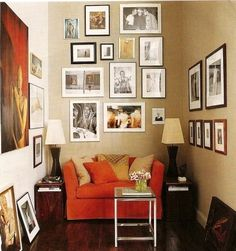 small space / reading nook or living room / neutral+ black + white + dark wood + pop of persimmon orange by may
