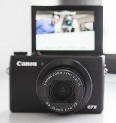 The Canon PowerShot G7X, which includes an LCD that flips 180 degrees.