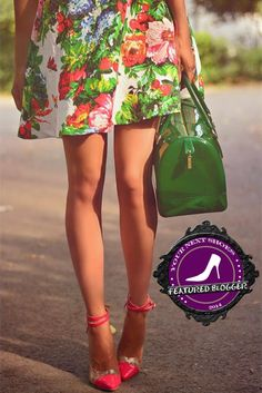 Paris of J'adore Fashion pairing a green printed dress with pink Voleta ankle-strap pumps