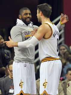 Dec. 20, 2015: Kyrie Irving, left, and Matthew Dellavedova celebrate from the bench during the fourth quarter of the Cavaliers' victory over the 76ers in Cleveland. Irving scored 12 points in his season debut to help the Cavaliers cruise 108-86 for their fifth straight win. Ken Blaze, USA TODAY Sports