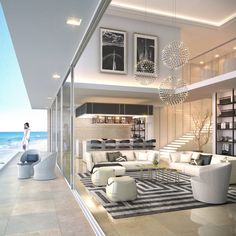 Penthouse design | modern penthouse| double volume living room | beach view living room | floating lit staircase |indoor outdoor