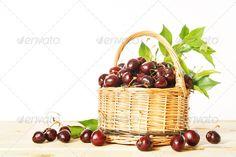 Ripe red cherry in a wicker basket ...  background, basket, berry, bright, cherries, cherry, delicious, dessert, diet, food, fresh, freshness, fruit, gourmet, green, healthy, juicy, leaf, natural, nature, organic, red, ripe, studio, summer, sweet, tasty, white, wicker