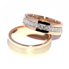 'Luxurious minimalist' is the name of the 14k rose gold pair of wedding rings with 2.1ct brilliant in the female style. More at www.haesjewellery.com