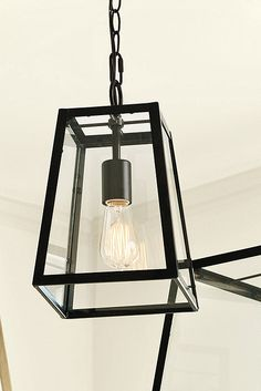 With its beautifully simple design and clear glass shade, our Eldridge Pendant makes a sophisticated, architectural statement in the entry, over a dining table or hung in multiples to illuminate a kitchen island. The frame is crafted of powder steel. Eldridge Pendant features: 6' hanging chain5Diam ceiling canopyHardwire only