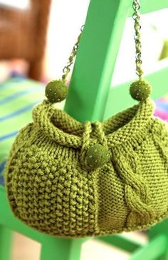 audrey knit purse. Using a chain with the yarn as a strap, won't stretch like knit stitches.