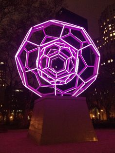 "Villareal's BUCKYBALL applies concepts of geometry and mathematical relationships within a towering 30-foot tall, illuminated sculpture. A commission of the Mad. Sq. Art program, Villareal's BUCKYBALL features two nested, geodesic sculptural spheres comprised of 180 LED tubes arranged in a series of pentagons and hexagons, known as a ""Fullerene,"" referring to the form's discovery by Buckminster Fuller."