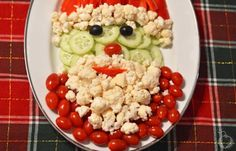 Don't you dare think about ordering those boring pre-made party trays! Instead, make this Santa Veggie Tray it will sure impress the crowd!