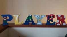 Letras decoradas tema Mario Bros(Player One) letras em mdf decoradas com tecido e feltro. Letras com 15cm de altura. Frete por conta do cliente. Valor referente a cada letra decorada.