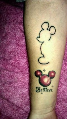 mickey mouse tattoo, like the upper one