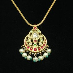 century Mughal pendant from India, made of yellow gold and studded with emeralds, Basara pearls, diamonds and rubies. indian-jewelry-art-architecture-jewel-of-the-lotus Mughal Jewelry, Pakistani Jewelry, Indian Jewelry, Antique Jewelry, Vintage Jewelry, Gold Jewellery Design, Jewelery, Silver Jewelry, Jewelry Art