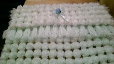 turn over pom pom  pram / moses basket blanket