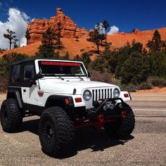 Jeep Country in a lifted Jeep Wrangler with Big tires and a winch
