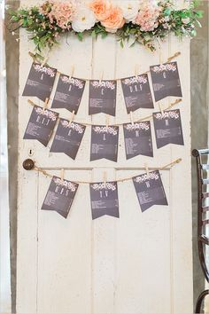 cute bunting seating chart on vintage door with flowers