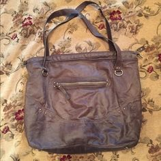 Bag by Innué Italian leather. Excellent condition. No signs of wear. Large enough to carry everything needed and wanted. It has a zipper inside and a zipper for top closure. There is also a zipper on the outside. Silver hardware and silver studs on bottom to protect leather. Innué Bags Shoulder Bags