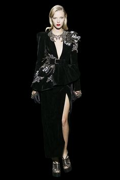 Jacket and split skirt in black velvet, embellished with birds set with crystals and feathers.