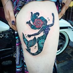 The Floral Mermaid Tattoo Design. This unique floral mermaid can get all your attention, so beware!