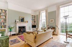 Light, bright and airy living room. Love the eau de nil walls.