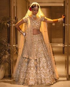 Bride Prachi Jain rocked a gold and ivory tulle lehenga like a diva. Tag a friend who'd rock this bridal look! Indian Bridal Outfits, Indian Bridal Lehenga, Indian Bridal Fashion, Indian Bridal Wear, Indian Dresses, Bridal Dresses, Bridal Sarees, Gold Lehenga Bridal, La Bayadere