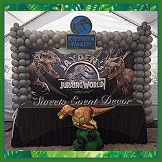 Jurassic World Theme Decoration by: Sweets Event Decor | Backdrop | Printed Backdrop | Tent Draping | Fabric Draping | Fabric Backdrop| Canopy Draping | Backdrop Draping | Pipe & Drape | Candy Table | Desserts Table | Floral Centerpieces | Floral Arrangements | Natural Flowers | Balloon Arch | Balloon Columns | Balloon Decor | Balloons